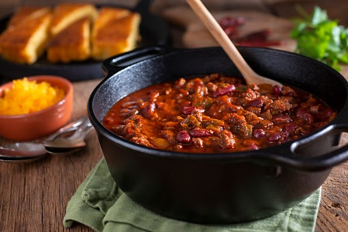 Classic Southwestern Chili in a Cast Iron Dutch Oven with Corn Bread and Cheddar Cheese